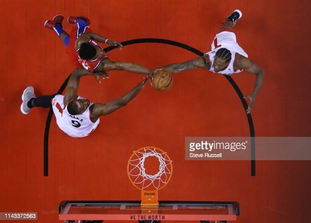 Philadelphia 76ers guard Jimmy Butler goes to the basket as Toronto Raptors center Serge Ibaka and Toronto Raptors forward Kawhi Leonard defend as...