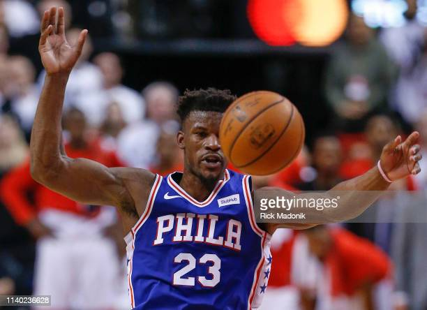Philadelphia 76ers guard Jimmy Butler has the ball knocked loose by Toronto Raptors center Marc Gasol who was called for a foul Toronto Raptors vs...