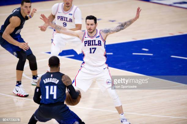 Philadelphia 76ers Guard JJ Redick guards Orlando Magic Guard DJ Augustin in the first half during the game between the Orlando Magic and...