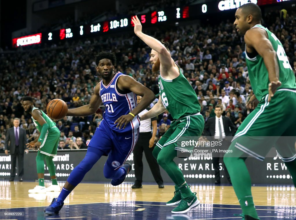 Philadelphia 76ers' Joel Embiid (left) and Boston Celtics' Aron Bynes in action during the NBA London Game 2018 at the O2 Arena, London.