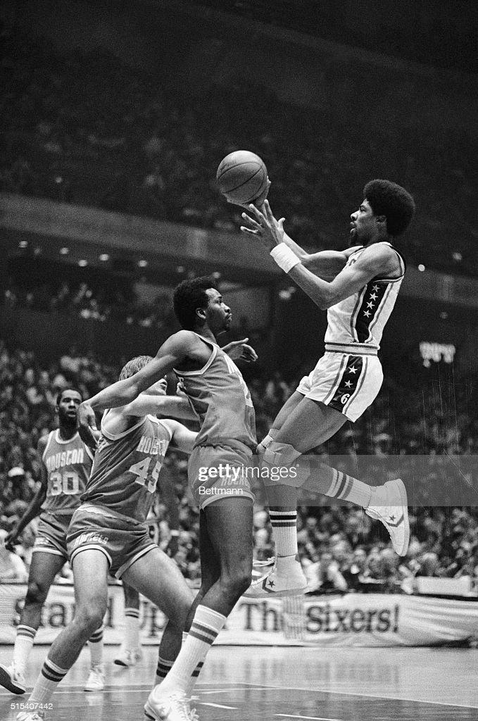 Philadelphia 76ers' Julius Erving leaps up against Houston Rockets