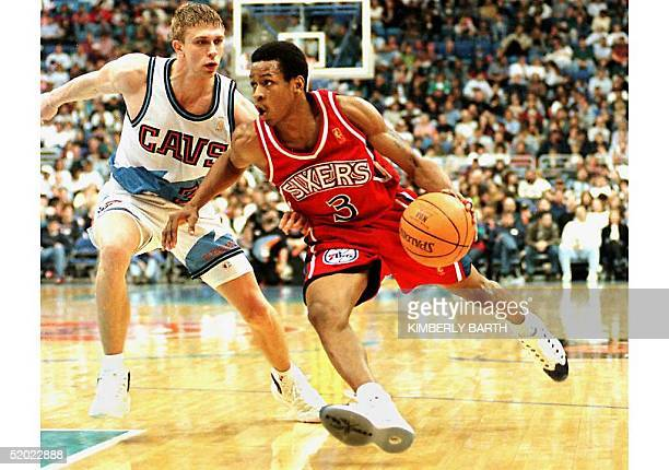 Philadelphia 76ers' rookie guard Allen Iverson drives for the basket against Cleveland Cavaliers guard Bobby Sura in game action12 April in Cleveland...