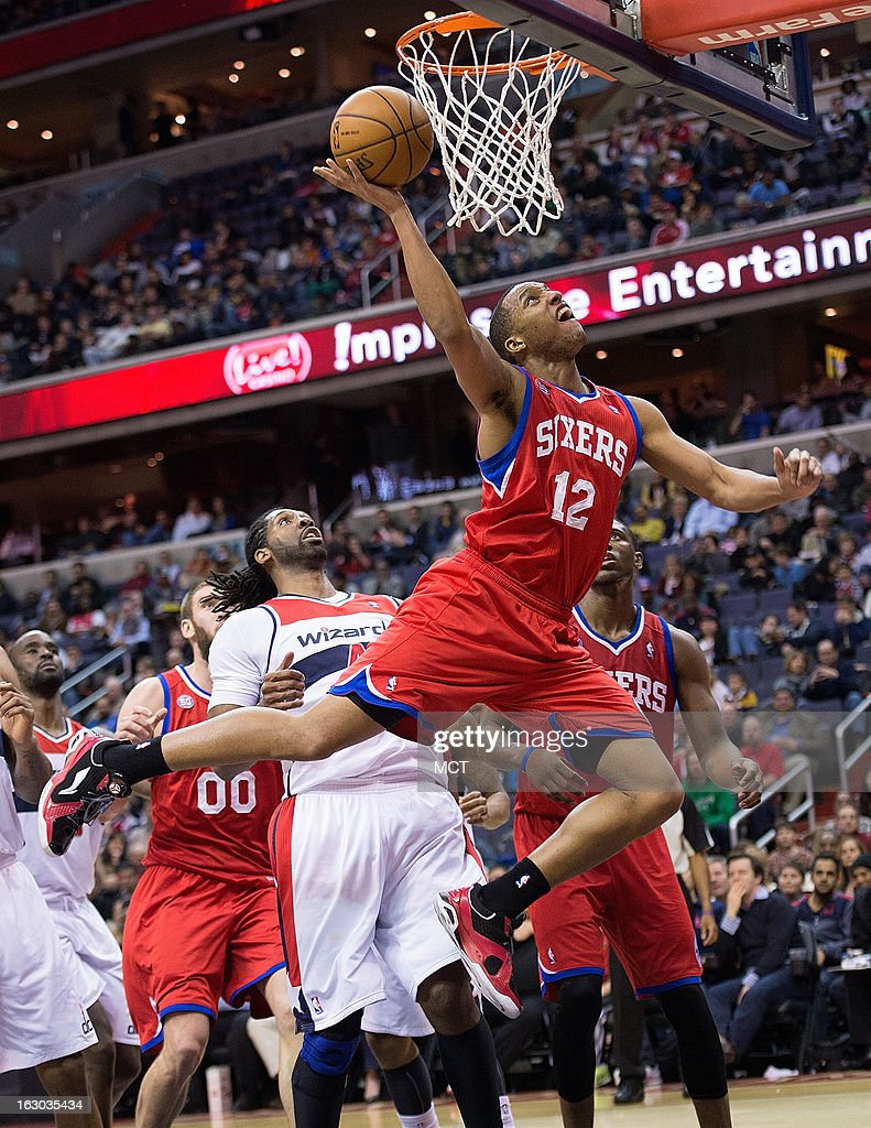 Philadelphia 76ers small forward Evan Turner (12) scores against the Washington Wizards during the first half of their game played at the Verizon Center in Washington, D.C., Sunday, March 3, 2013.