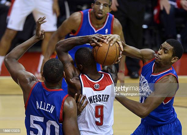 Philadelphia 76ers small forward Hollis Thompson right. Steals the rebound away from Washington Wizards small forward Martell Webster under the...