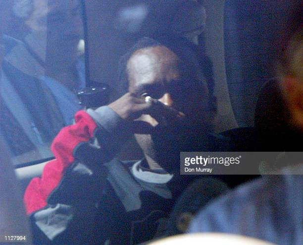 Philadelphia 76ers star Allen Iverson is driven away from police headquarters after his arraignment July 16 2002 in Philadelphia Pennsylvania Iverson...