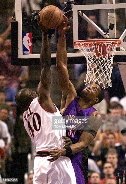 Philadelphia 76ers' Tyron Hill has his shot blocked by Toronto Raptors' Antonio Davis during their NBA Eastern Conference semi-final game seven 20...