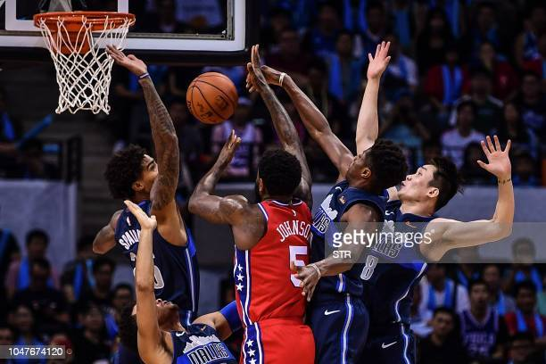 Philadelphia 76ers' US Amir Johnson tries to shoot during the preseason NBA basketball game between Dallas Mavericks and Philadelphia 76ers in...