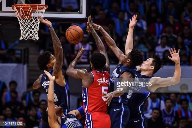 TOPSHOT Philadelphia 76ers' US Amir Johnson tries to shoot during the preseason NBA basketball game between Dallas Mavericks and Philadelphia 76ers...