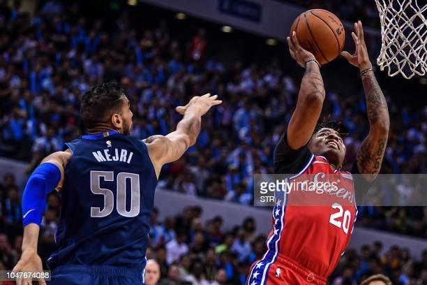 Philadelphia 76ers' US Markelle Fultz dunks during the preseason NBA basketball game between Dallas Mavericks and Philadelphia 76ers in Shenzhen in...