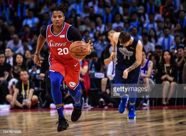 Philadelphia 76ers' US Markelle Fultz runs with the ball during the preseason NBA basketball game between Dallas Mavericks and Philadelphia 76ers in...