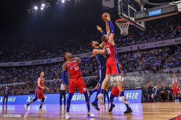 Philadelphia 76ers' US Mike Muscala dunks during the preseason NBA basketball game between Dallas Mavericks and Philadelphia 76ers in Shenzhen in...