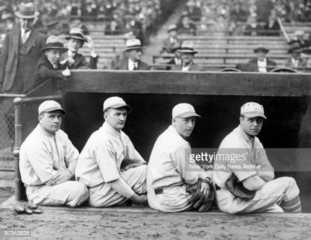 Philadelphia Athletics' third baseman Jimmy Dykes shortstop Joe Boley second baseman Max Bishop and first baseman Jimmie Foxx sitt on the dugout...