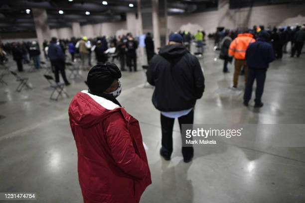 Philadelphia city employees queue to schedule their second COVID-19 vaccine shot after receiving their first at a FEMA community vaccination center...
