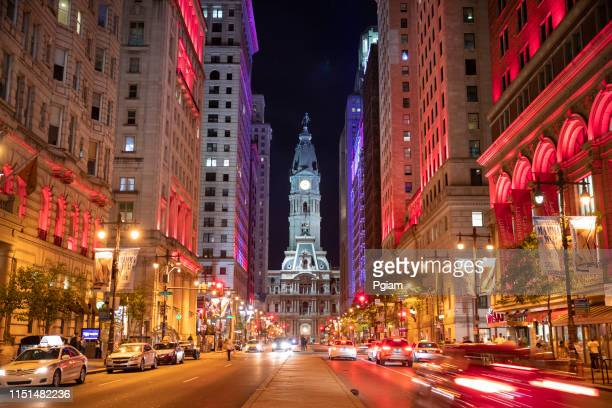 philadelphia city hall and clock tower on broad street at night - philadelphia stock pictures, royalty-free photos & images