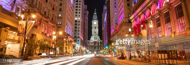 philadelphia city hall and clock tower panorama on broad street at night - philadelphia pennsylvania stock pictures, royalty-free photos & images