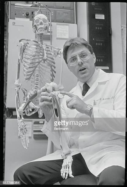 Dr Richard Schmidt Medical Director of the Bone Bank at the University of Pennsylvania points out the area on a laboratory section skeleton where...