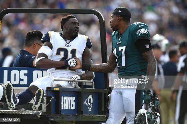 Philadelphia Eagles Alshon Jeffery consoles Los Angeles Rams Cornerback Kayvon Webster while being carted off the field during an NFL game between...