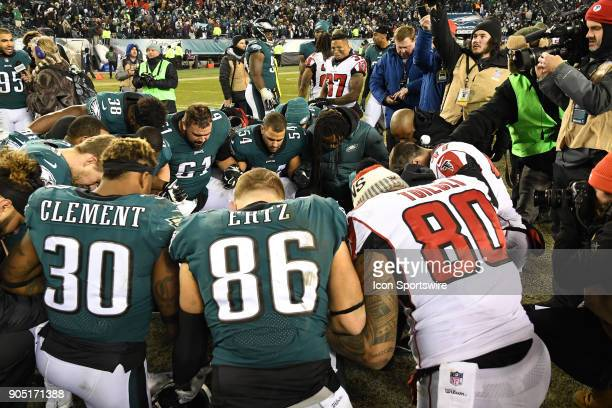 Philadelphia Eagles and Atlanta Falcons pray during the NFC Divisional Playoff game between the Philadelphia Eagles and the Atlanta Falcons on...