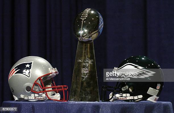 Philadelphia Eagles and New England Patriots helmets face off with the Vince Lombardi Trophy at NFL Commissioner Paul Tagliabue during a press...