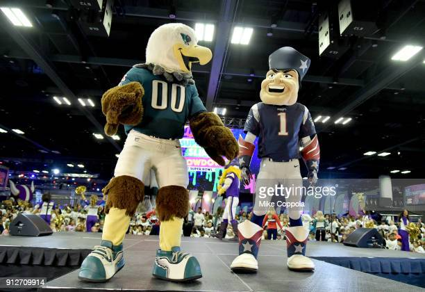 Philadelphia Eagles and New England Patriots mascots are seen onstage before the JoJo Siwa performs at Nickelodeon at the Super Bowl Expereince...