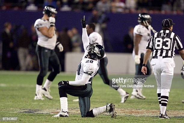 Philadelphia Eagles' Brian Dawkins celebrates after New York Giants' quarterback Kerry Collins fumbled on the last drive to give the Eagles the win...