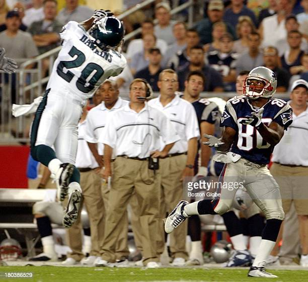 Philadelphia Eagles Brian Dawkins leaps high in front of Patriots Troy Brown to intercept Tom Brady during the second quarter of the preseason game...