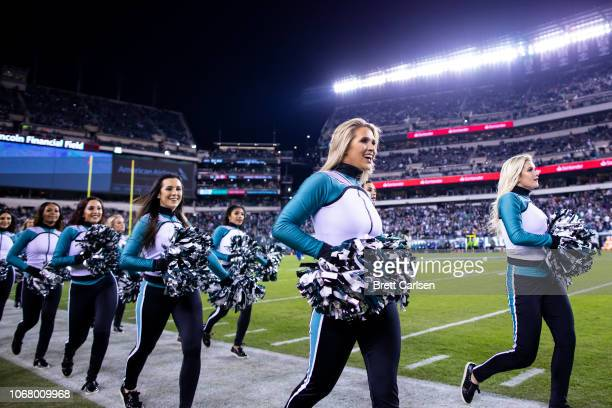 Philadelphia Eagles cheerleaders walk on the sideline before the game between the Philadelphia Eagles and the Dallas Cowboys at Lincoln Financial...
