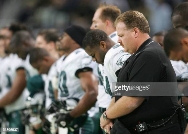 Philadelphia Eagles coach Andy Reid observes a moment of silence for former Eagles and Green Bay Packers star Reggie White who passes away December...