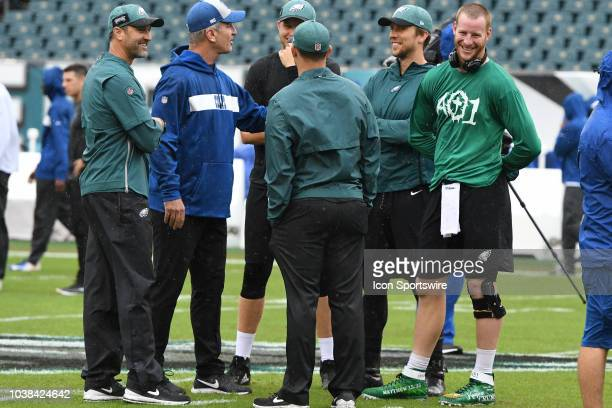 Philadelphia Eagles coach Mike Groh and Indianapolis head coach Frank Reich chat with Eagles quarterbacks during the game between the Indianapolis...