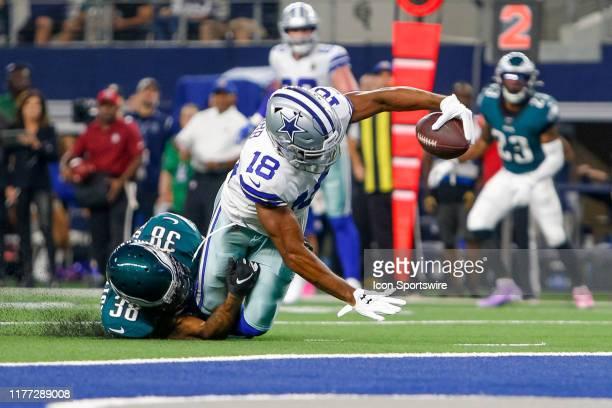 Philadelphia Eagles Cornerback Orlando Scandrick tackles Dallas Cowboys Wide Receiver Randall Cobb just short of the goal line during the game...
