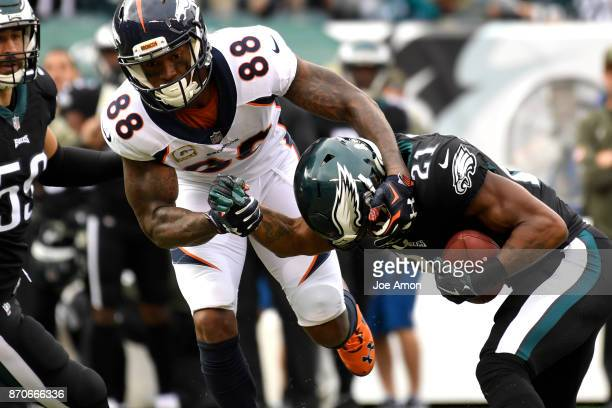 Philadelphia Eagles cornerback Patrick Robinson gets an early interception from Denver Broncos wide receiver Demaryius Thomas in the first half as...