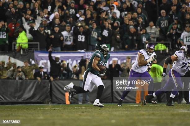 Philadelphia Eagles cornerback Patrick Robinson runs the ball after his interception for a touchdown during the NFC Championship game between the...