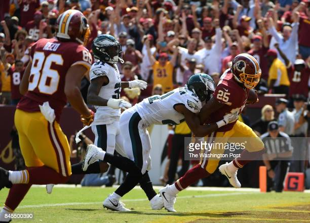 Philadelphia Eagles defensive back Patrick Robinson tries to bring down Washington Redskins running back Chris Thompson as he scores a touchdown in...