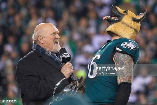 Philadelphia Eagles defensive end Chris Long celebrates by wearing a dog mask with Fox Sports analyst Terry Bradshaw after the NFC Championship Game...
