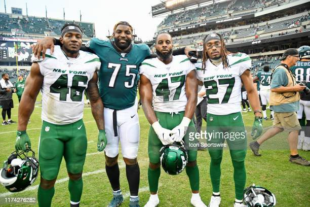 Philadelphia Eagles defensive end Vinny Curry poses with New York Jets Linebacker Neville Hewitt New York Jets Linebacker Albert McClellan and New...