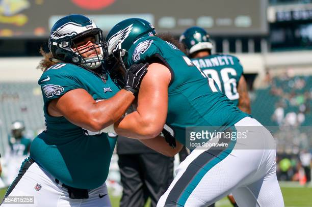 Philadelphia Eagles defensive tackle Elijah Qualls and Philadelphia Eagles offensive guard Isaac Seumalo warm up during the NFL game between the New...