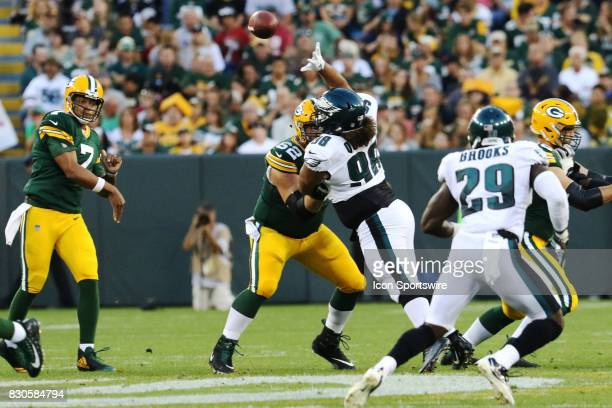 Philadelphia Eagles defensive tackle Elijah Qualls reaches for a Green Bay Packers quarterback Brett Hundley pass during a football game between the...
