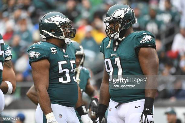 Philadelphia Eagles defensive tackle Fletcher Cox and Philadelphia Eagles defensive end Brandon Graham discuss a play during a NFL football game...