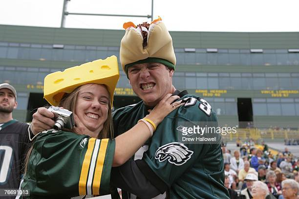 Philadelphia Eagles fan and Green Bay Packers fan have a little fun before the game against the Green Bay Packers on September 9 2007 at Lambeau...
