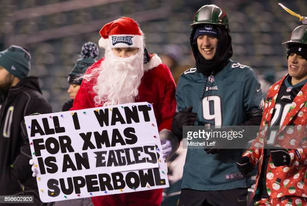 Philadelphia Eagles fan dressed as Santa holds a sign prior to the game against the Oakland Raiders at Lincoln Financial Field on December 25 2017 in...