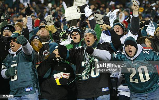 Philadelphia Eagles fans celebrate after running back Duce Staley of the Philadelphia Eagles scored on a 7-yard touchdown catch in the second quarter...