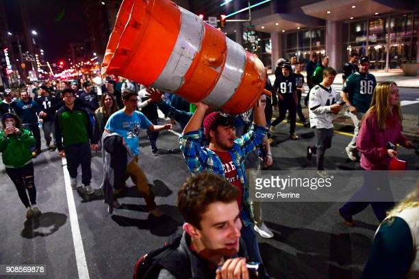 Philadelphia Eagles fans celebrate running and marching on North Broad Street downtown near City Hall on January 21 2018 in Philadelphia Pennsylvania...