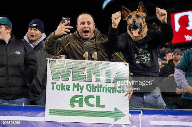 Philadelphia Eagles fans celebrate with signs and a dog mask during the NFC Championship Game between the Minnesota Vikings and the Philadelphia...