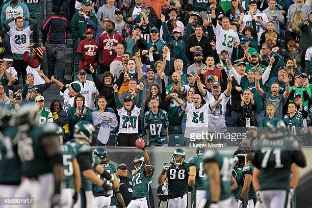 Philadelphia Eagles fans cheer after Brandon Boykin intercepts a pass in the fourth quarter during a game against the Washington Redskins on November...