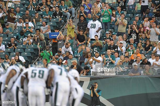 Philadelphia Eagles fans cheer as quarterback Michael Vick comes onto the field for the first time during the game against the Jacksonville Jaguars...