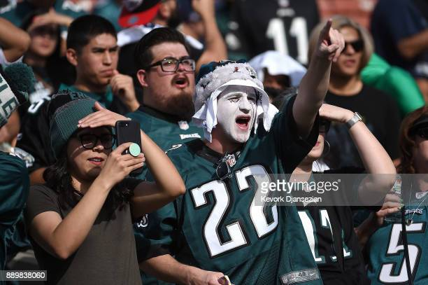 Philadelphia Eagles fans cheer during the game against the Los Angeles Rams at the Los Angeles Memorial Coliseum on December 10 2017 in Los Angeles...