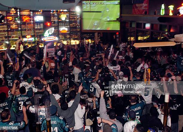 Philadelphia Eagles fans react as they watch Super Bowl XXXIX at Chickie's and Pete's bar and restaurant February 6 2005 in Philadelphia Pennsylvania...