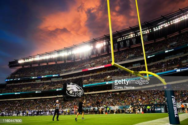 Philadelphia Eagles flagbearer flies the team logo after the first score of the game against the Tennessee Titans during the first quarter of a...