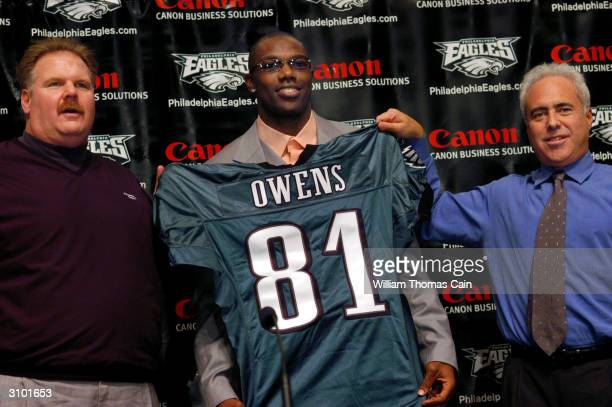 Philadelphia Eagles head coach Andy Reid newly acquired Philadelphia Eagles wide receiver Terrell Owens and Philadelphia Eagles owner Jeffrey Lurie...