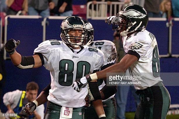 Philadelphia Eagles' James Thrash celebrates with teammate Todd Pinkston after Thrash caught an 18yard touchdown pass from quarterback Donovan McNabb...